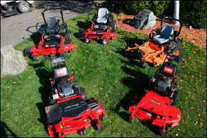 Six Riding Lawn Mowers Setup Outside